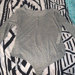 Forever 21 Size large body suit with cute buttons